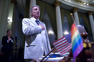 Assemblyman Tom Ammiano, D-San Francisco, leads the Pledge of Allegiance during the LGBT Pride Month Celebration