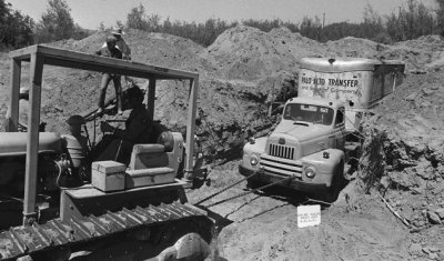 Officials remove a truck buried at a rock quarry in Livermore, Calif., July 20, 1976 in which 26 Chowchilla school children and their bus driver were held captive.